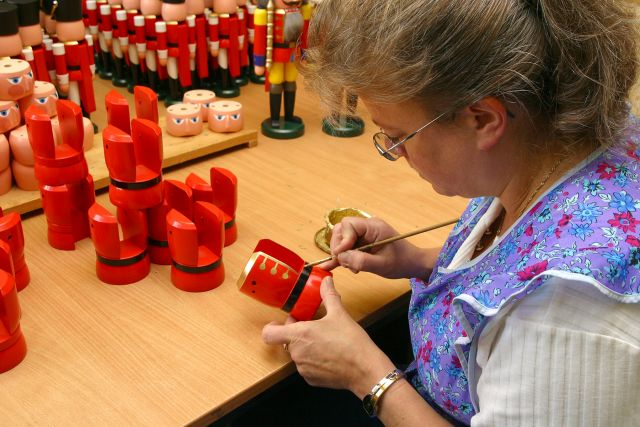 An artisan hand-paints the nutcrackers in Saxony